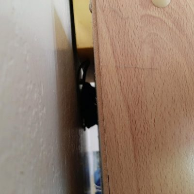 Rodent hidden behind the cabinet at the top of a cabinet in the Kitchen during mid day trapped by two Terriers 2of2.
